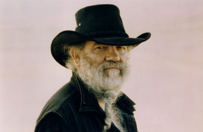 composer lamonte young wearing a black hat and shirt